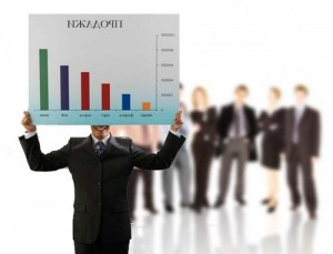 Businessman Holding Graph --- Image by © Royalty-Free/Corbis